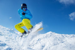 Snowboarder jumping high in the air. Winter vacation -  snowboarder jumping high in the air on a cold sunny day Stock Images