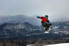 Snowboarder jumping midair Royalty Free Stock Images