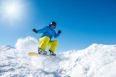 Snowboarder jumping. In the mountains in winter Stock Images