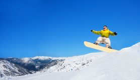 Snowboarder jumping from rump Royalty Free Stock Photo