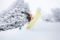 Snowboarder jumping on ski slope Royalty Free Stock Image