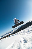 Snowboarder jumping in the snow Royalty Free Stock Photos