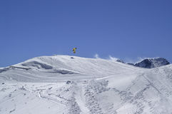 Snowboarder jumping in terrain park at ski resort on sun winter Stock Photography