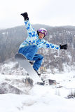 Snowboarder Jumps On Snowboard Stock Photo