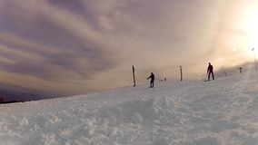 Snowboarder Jumps on skyslope at sunset stock video footage