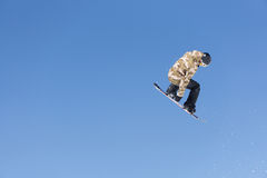 Snowboarder jumps in Snow Park Stock Images