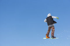Snowboarder jumps in Snow Park Stock Photo