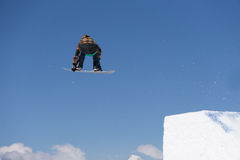 Snowboarder jumps in Snow Park Royalty Free Stock Images