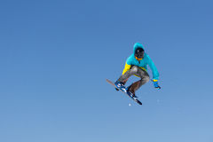 Snowboarder jumps in Snow Park Stock Photography