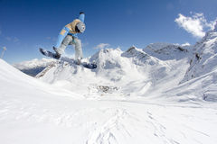 Snowboarder jumps in Snow Park Royalty Free Stock Image