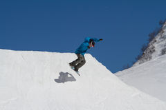 Snowboarder jumps in Snow Park,  ski resort Stock Photography