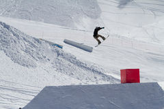 Snowboarder jumps in Snow Park,  ski resort Royalty Free Stock Images