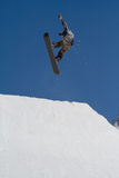 Snowboarder jumps in Snow Park,  ski resort Royalty Free Stock Photo