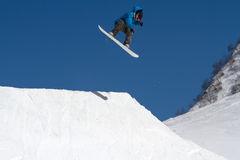 Snowboarder jumps in Snow Park,  ski resort Stock Images