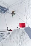 Snowboarder jumps in Snow Park,  ski resort Royalty Free Stock Photography