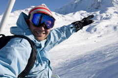 Snowboarder on lift at ski resort Stock Images