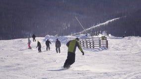 Snowboarder looking at view ski resort stock video