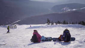 Snowboarder looking at view ski resort stock video footage