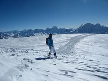 The snowboarder looks at the endless space and is going to slide on the track royalty free stock photos
