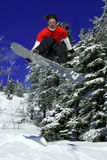 Snowboarder make a jump Royalty Free Stock Photos