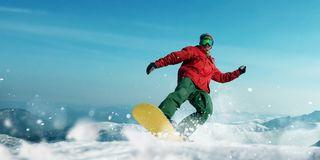 Snowboarder makes a jump, sportsman in action. Snowboarder makes a jump, front view, sportsman in action. Winter active sport, extreme lifestyle. Snowboarding in Royalty Free Stock Photo
