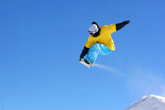 Snowboarder mid flight,. Snow Boarders, Remarkables, Queenstown, Central Otago, south island, New Zealand Royalty Free Stock Photography