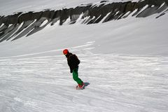 Snowboarder in motion, the snowboarder on the ski slope Stock Photography