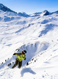 Snowboarder and mountain. Ski resort Les Arcs. France Royalty Free Stock Photography