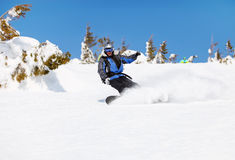 Snowboarder on a mountain slope Stock Image