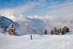Snowboarder in mountains Stock Photos