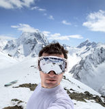 Snowboarder in mountains of the Caucasus Royalty Free Stock Photo