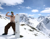 Snowboarder in mountains of the Caucasus. Snowboarder on the back of high Caucasus Mountains Royalty Free Stock Photo