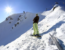 Snowboarder in mountains of the Caucasus. Snowboarder on the back of high Caucasus Mountains Stock Image