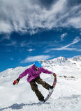 Snowboarder in mountains Royalty Free Stock Image