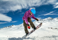 Snowboarder in mountains Royalty Free Stock Photos