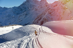 Snowboarder moving down Stock Photography