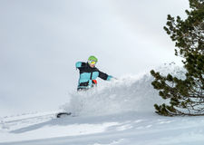 Snowboarder moving down Royalty Free Stock Images