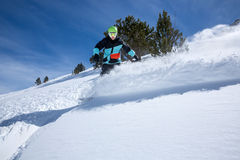 Snowboarder moving down Stock Image