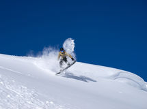 Snowboarder moving down Stock Images