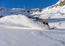 Snowboarder moving down Royalty Free Stock Photos
