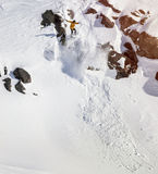 Snowboarder moving down in mountains Royalty Free Stock Images