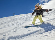 Snowboarder moving down Royalty Free Stock Image