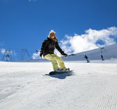 Snowboarder moving down Stock Photos