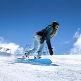 Snowboarder moving down Royalty Free Stock Photo