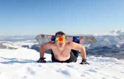 Snowboarder na inclinação de montanha Imagens de Stock