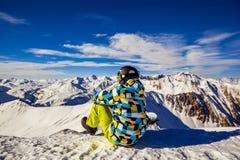 Snowboarder na wierzchołku góra obraz royalty free