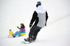 Snowboarder nel moto, lo snowboarder sul pendio dello sci Fotografia Stock Libera da Diritti