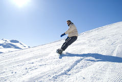 Snowboarder nell'azione Fotografia Stock Libera da Diritti