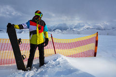 Snowboarder next to  partition grid safety Royalty Free Stock Image