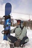Snowboarder obsiadanie fotografia royalty free